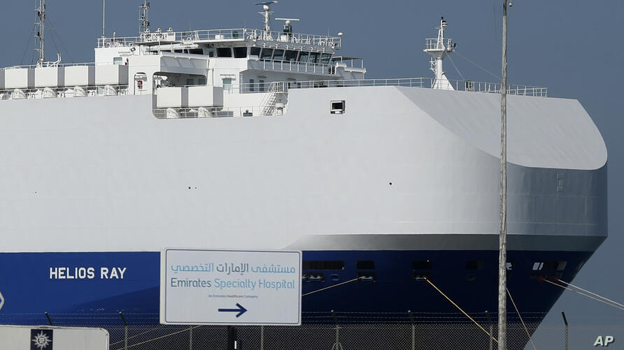 The Israeli-owned cargo ship, Helios Ray, sits docked in port after arriving earlier in Dubai, United Arab Emirates, Sunday,…