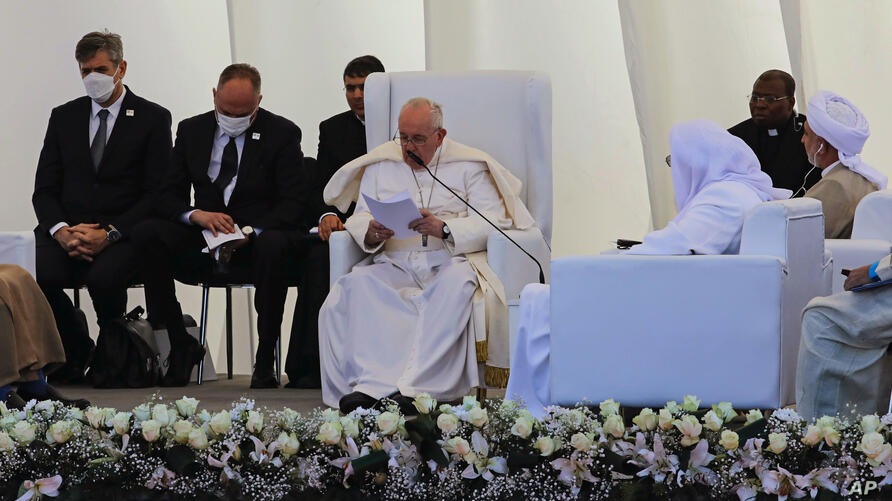 Pope Francis, center, speaks during an interreligious meeting near the archaeological site of Ur near Nasiriyah, Iraq, Saturday…