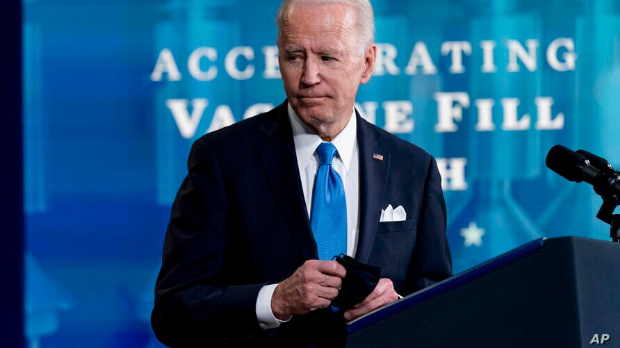 President Joe Biden leaves an event with Johnson and Johnson Chairman and CEO Alex Gorsky, and Merck Chairman and CEO Kenneth…