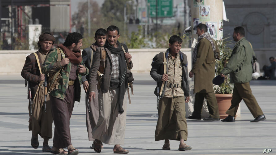 Armed Houthi supporters attend a funeral procession for Houthi fighters who were killed in recent fighting with forces of Yemen…