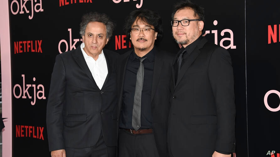 Cinematographer Darius Khondji, left, director, co-screenwriter and producer Bong Joon Ho and producer Dooho Choi attend the…