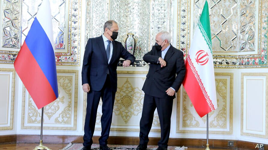 In this photo released by the Iranian Foreign Ministry, Iranian Foreign Minister Mohammad Javad Zarif, right, and Russian…
