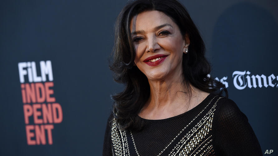 """Shohreh Aghdashloo, a cast member and executive producer of """"Simple Wedding,"""" poses at the premiere of the film at the 2018 Los…"""