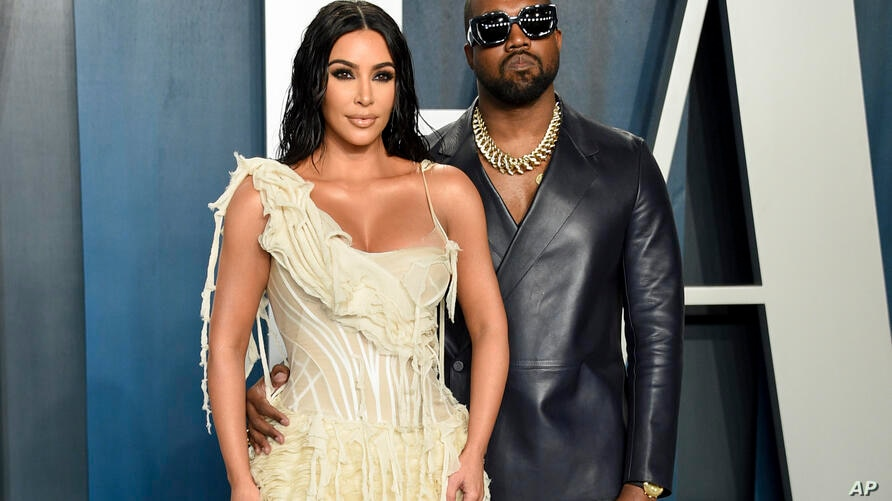 FILE -Kim Kardashian West, left, and Kanye West arrive at the Vanity Fair Oscar Party in Beverly Hills, Calif. on Feb. 9, 2020…