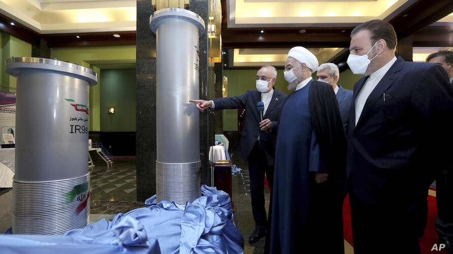 In this photo released by the official website of the office of the Iranian Presidency, President Hassan Rouhani, second right,…