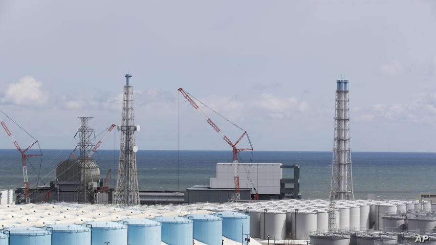 FILE - In this Feb. 27, 2021, file photo, the Pacific Ocean looks over nuclear reactor units of No. 3, left, and 4 at the…