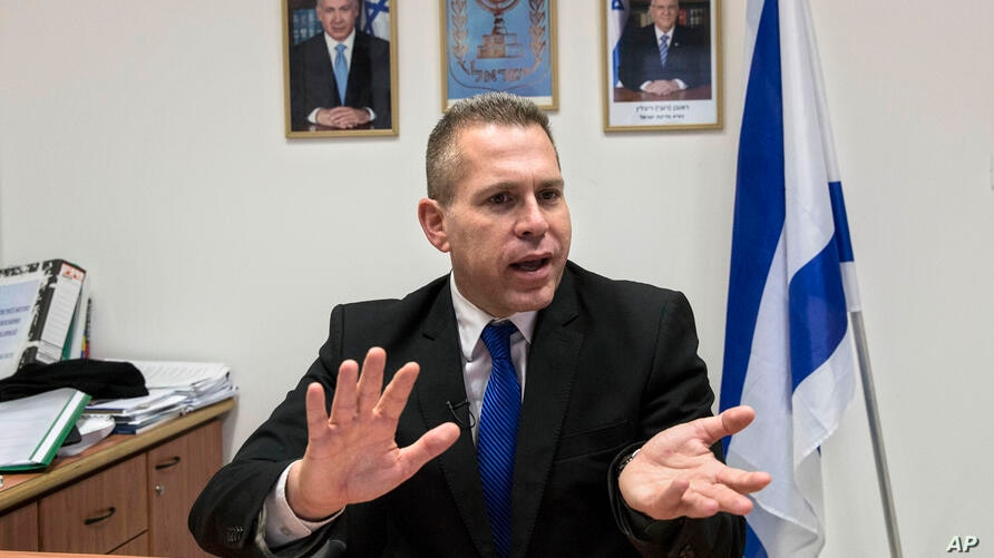 In this Thursday, July 14, 2016 photo, Israeli Public Security Minister Gilad Erdan speaks during an interview with The…