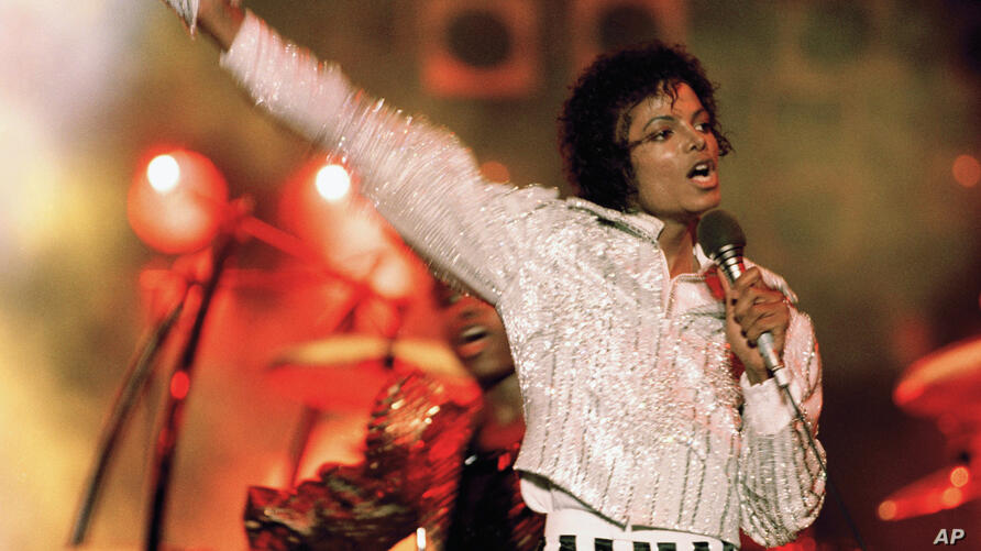 """FILE - In this July 1984 file photo, Michael Jackson performs during the """"Victory Tour."""" Julien's Auctions announced on Oct. 13…"""