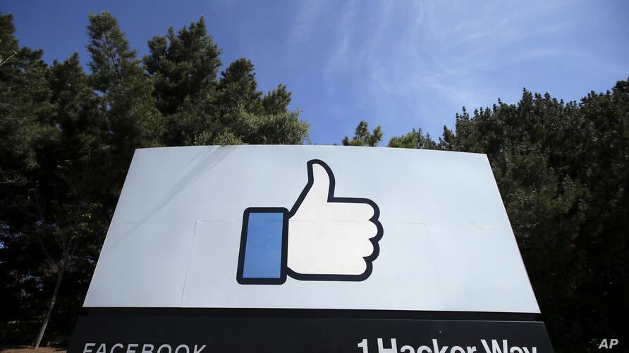 FILE - In this April 14, 2020, file photo, the thumbs up Like logo is shown on a sign at Facebook headquarters in Menlo Park,…