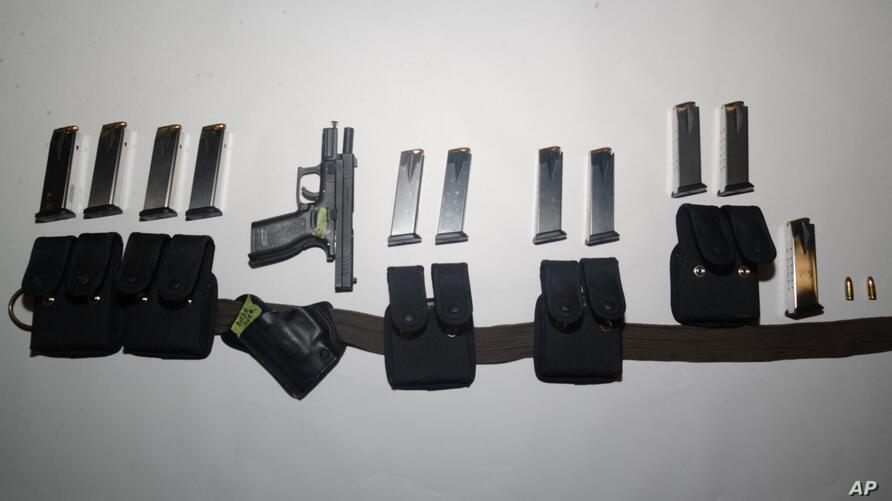 This undated photo provided by the Santa Clara County Sheriff's Office shows guns and ammunition magazines found at the…