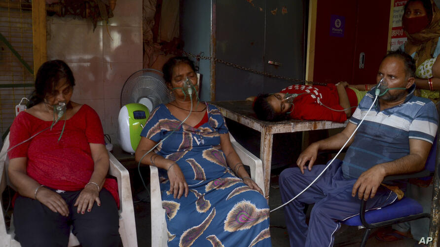 COVID-19 patients receive oxygen outside a Gurdwara, a Sikh house of worship, in New Delhi, India, Saturday, May 1, 2021. India…