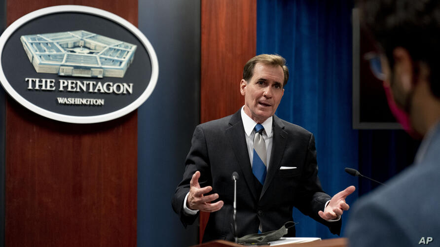 Pentagon spokesman John Kirby speaks to a reporter following a media briefing at the Pentagon in Washington, Monday, May 3,…