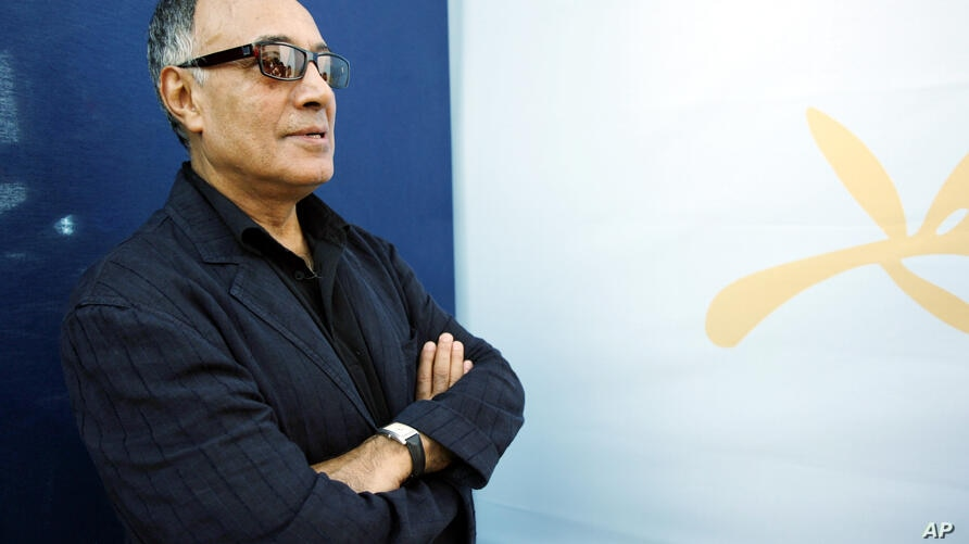 """Iranian director Abbas Kiarostami poses during a photo call for the film """"Chacun Son Cinema"""" (To Each His Own Cinema) at the…"""