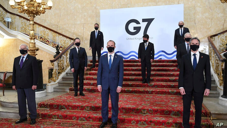 G7 foreign ministers wear face masks and are socially distanced for a group photo, with front row left, European High…