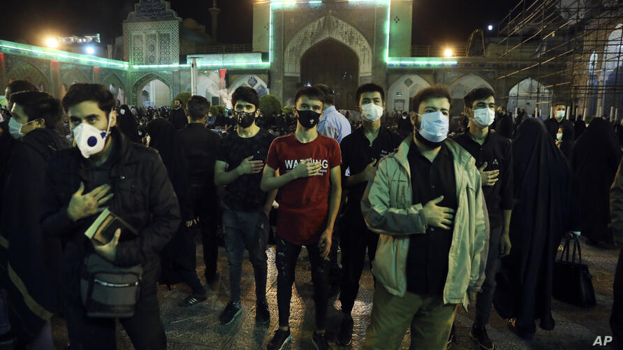 Worshippers wearing protective face masks to help prevent the spread of the coronavirus pray at the Laylat al-Qadr, or the…
