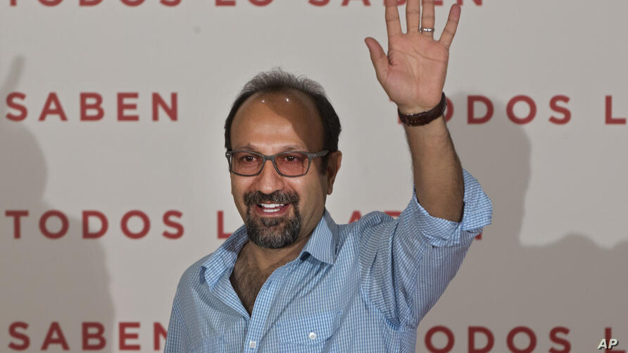 Film director Asghar Farhadi waves during a photocall to present the movie Everybody Knows (Todos lo saben) in Madrid, Spain,…