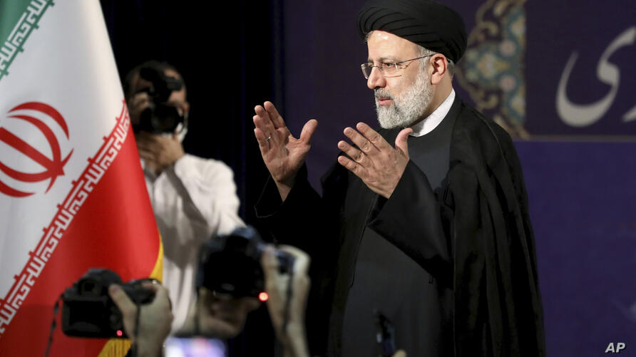 Ebrahim Raisi, head of Iran's judiciary leaves a news conference after registering his candidacy for the June 18 presidential…