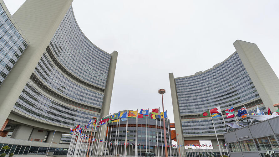 FILE - In this Monday, May ۲۴, ۲۰۲۱ file photo, the flag of UN states wave in front of the the International Center building…