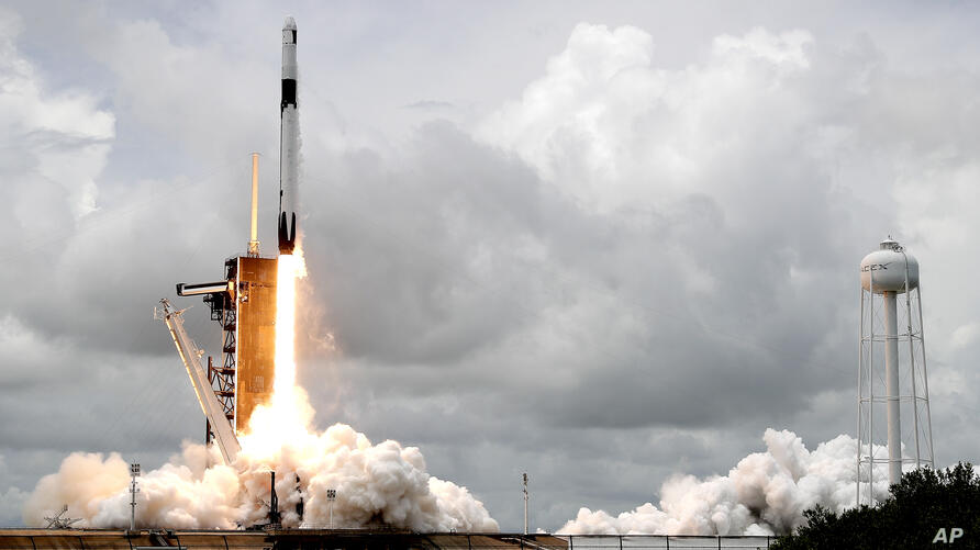 A SpaceX Falcon 9 rocket with a Dragon 2 spacecraft lifts off on pad 39A at the Kennedy Space Center for a re-supply mission to…