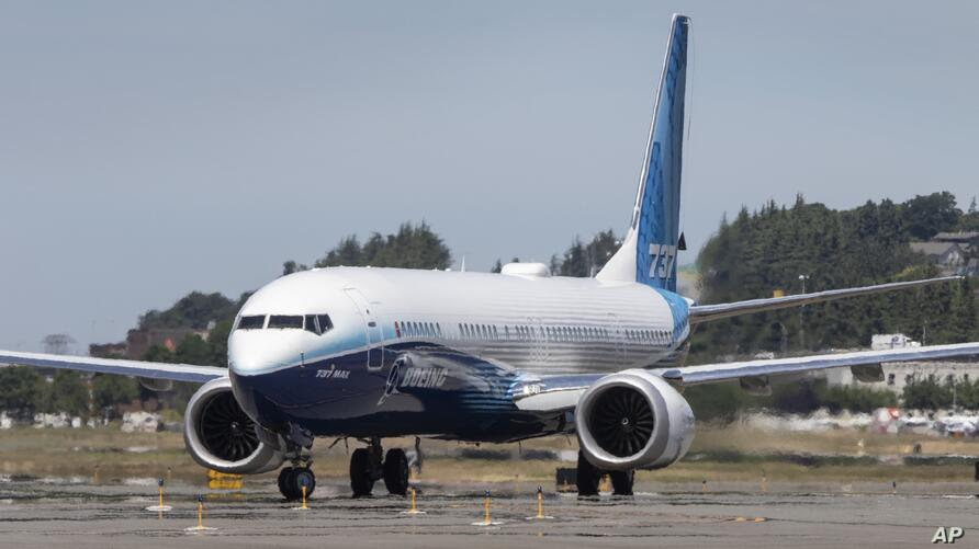 After landing, the final version of the 737 MAX, the MAX 10, taxis towards the Seattle Delivery Center at Boeing Field after a…