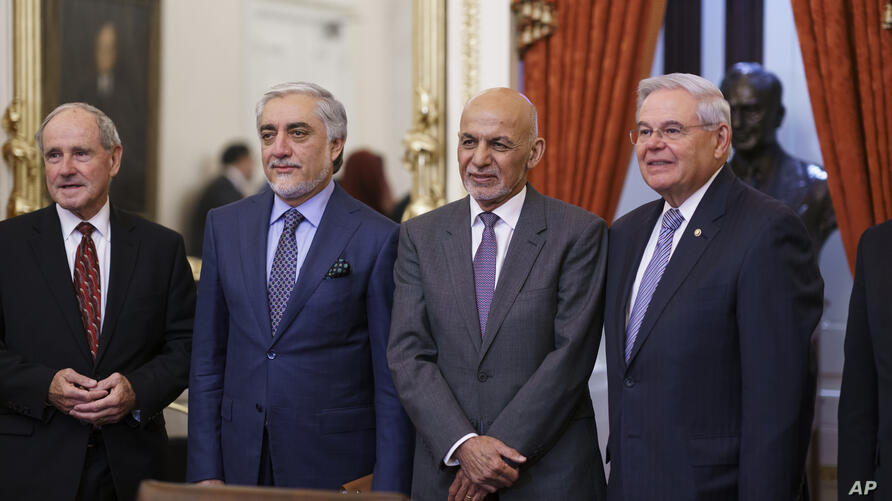 From left, Sen. Jim Risch, R-Idaho, Abdullah Abdullah who leads the High Council for National Reconciliation in Afghanistan,…