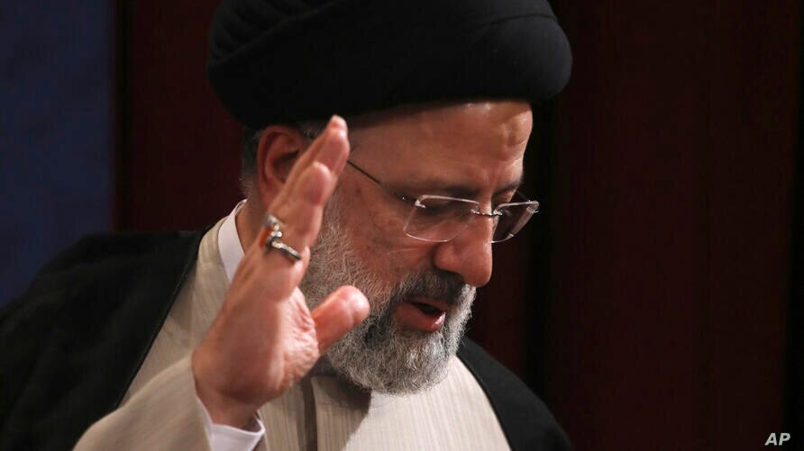 In this June 21, 2021, photo, Iran's new President-elect Ebrahim Raisi waves at the conclusion of his news conference in Tehran…