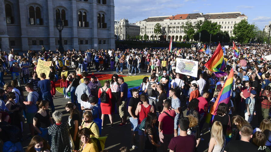 People gather during an LGBT rights demonstration in front of the Hungarian Parliament building in Budapest, Hungary on June…