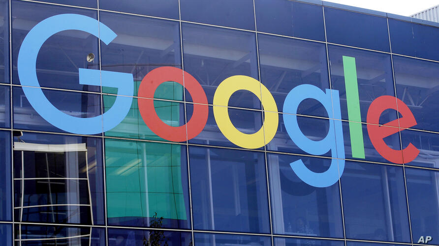 FILE - This Sept. 24, 2019, file photo shows a sign on a Google building at their campus in Mountain View, Calif. Google was…