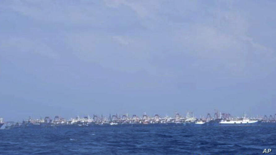 In this photo provided on Sunday, March 21, by the Philippine Coast Guard/National Task Force-West Philippine Sea, some of the…