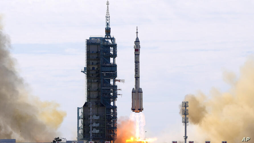A Long March-2F Y12 rocket carrying a crew of Chinese astronauts in a Shenzhou-12 spaceship lifts off at the Jiuquan Satellite…