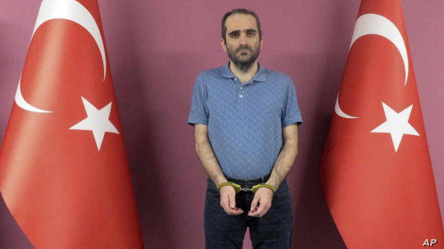 Selahattin Gulen, a nephew of U.S.-based Muslim cleric Fethullah Gulen, stands between Turkish flags in this photo provided by…