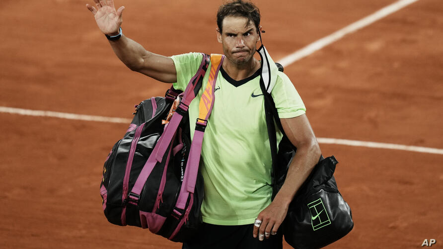 Spain's Rafael Nadal waves to the crowd after losing to Serbia's Novak Djokovic in their semifinal match of the French Open…