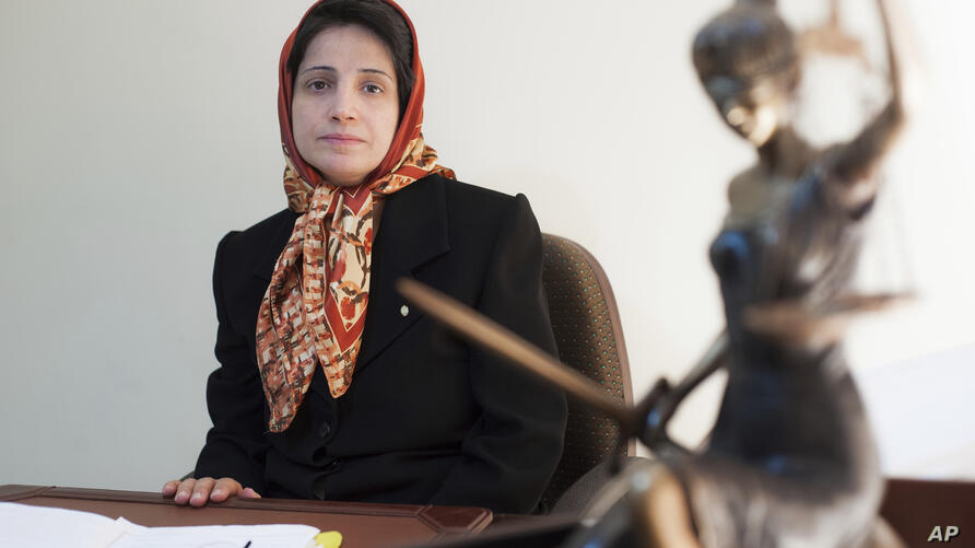 FILE - In this Nov. 1, 2008 photo, Iranian human rights lawyer Nasrin Sotoudeh, poses for a photograph in her office in Tehran,…