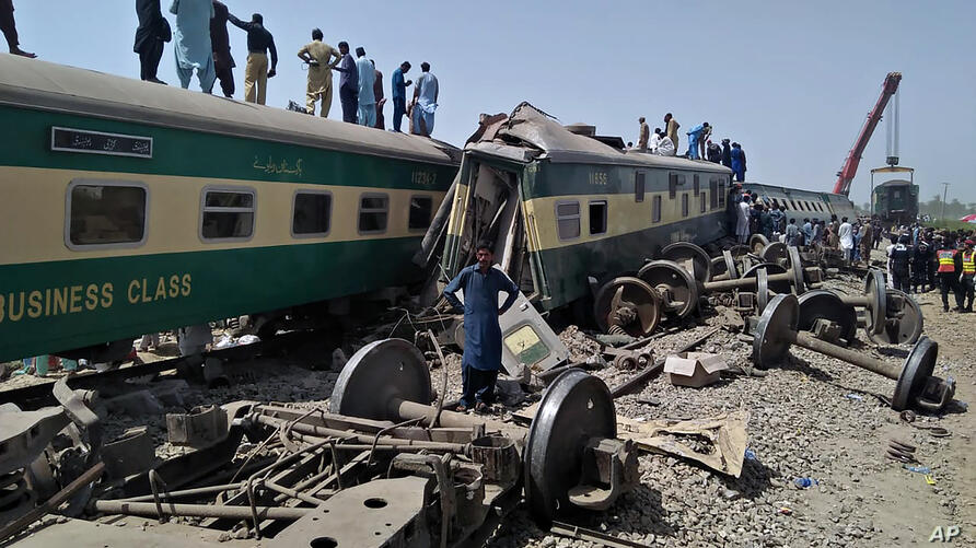 Soldiers and volunteers work at the site of a train collision in Ghotki district in southern Pakistan, Monday, June 7, 2021…