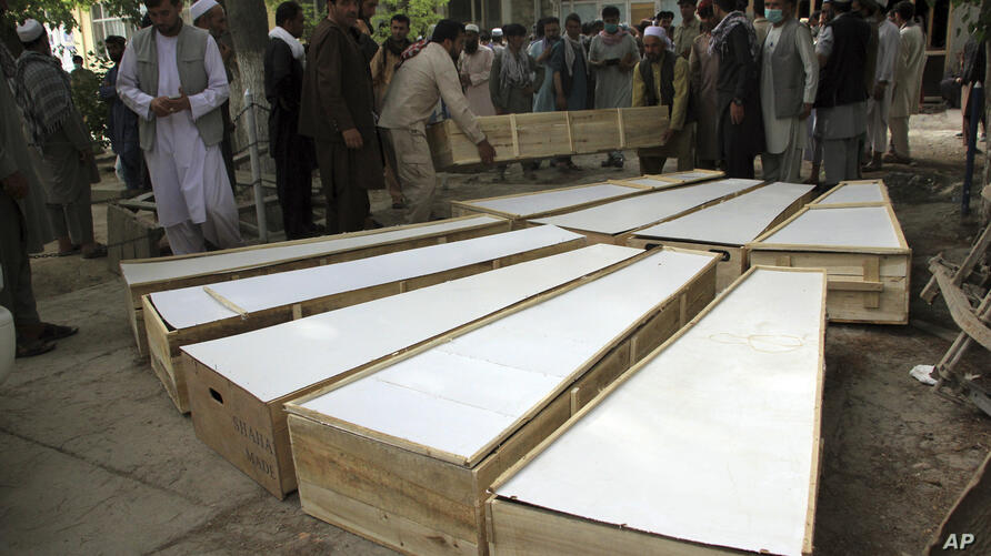 The coffins of the victims in Tuesday's attack are placed on the ground at a hospital in northern Baghlan province, Afghanistan…