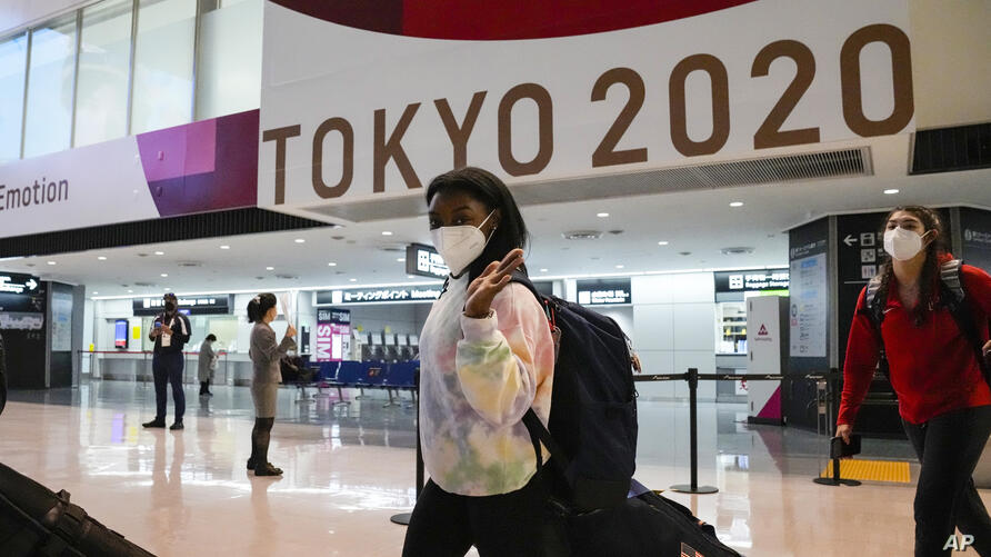 Simone Biles and the U.S. Women's Gymnastics team arrive for the Tokyo 2020 Summer Olympic Games at Narita International…