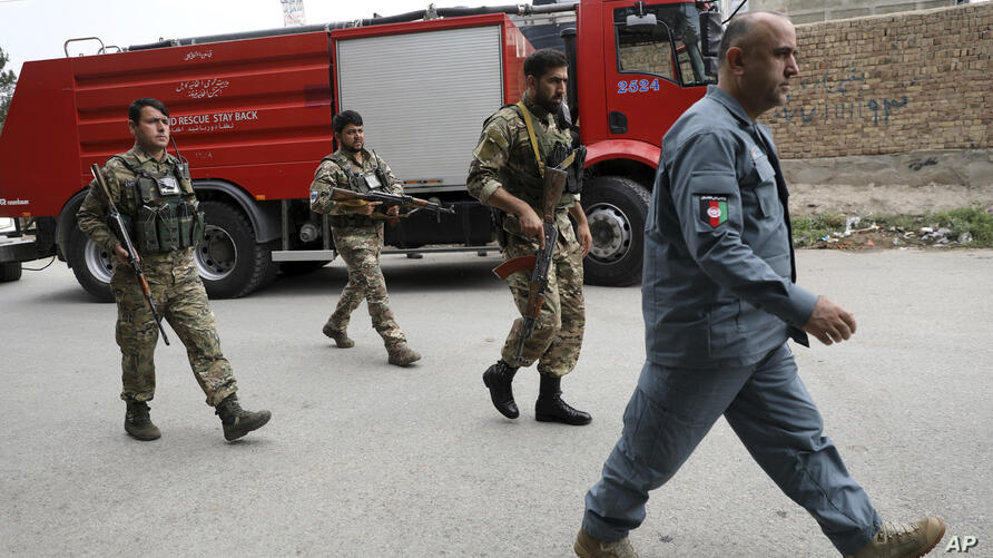 Security personnel arrive at the site of a rocket attack in Kabul, Afghanistan, Tuesday, July 20, 2021. At least three rockets…