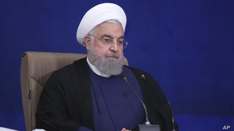 In this photo released by the official website of the office of the Iranian Presidency, President Hassan Rouhani attends a…