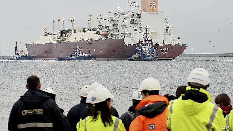 In this file photo taken Dec. 11, 2015 at the Baltic port of Swinoujscie, Poland, giant liquefied natural gas tanker Al Nuaman,…