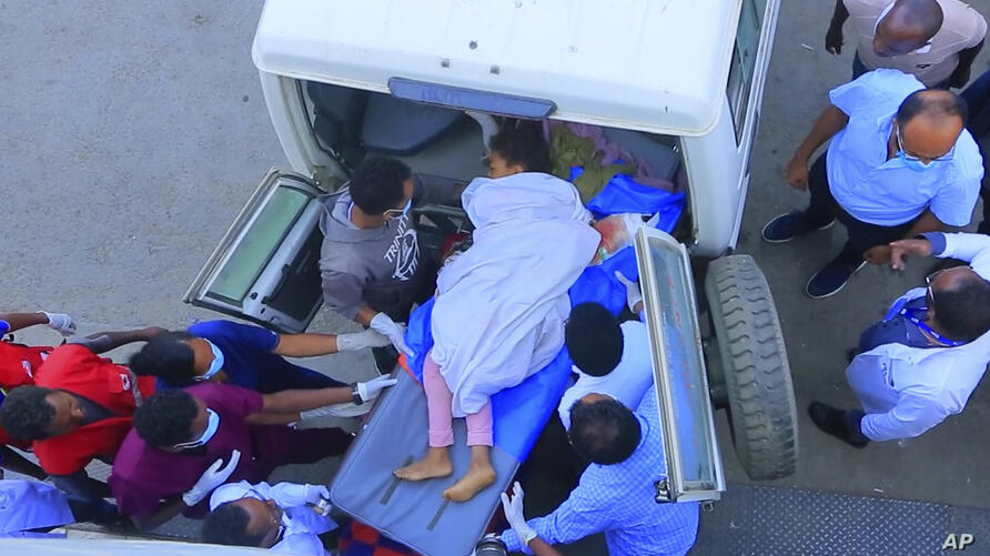 In this image made from video, an injured victim of an alleged airstrike on a village arrives in an ambulance at the Ayder…