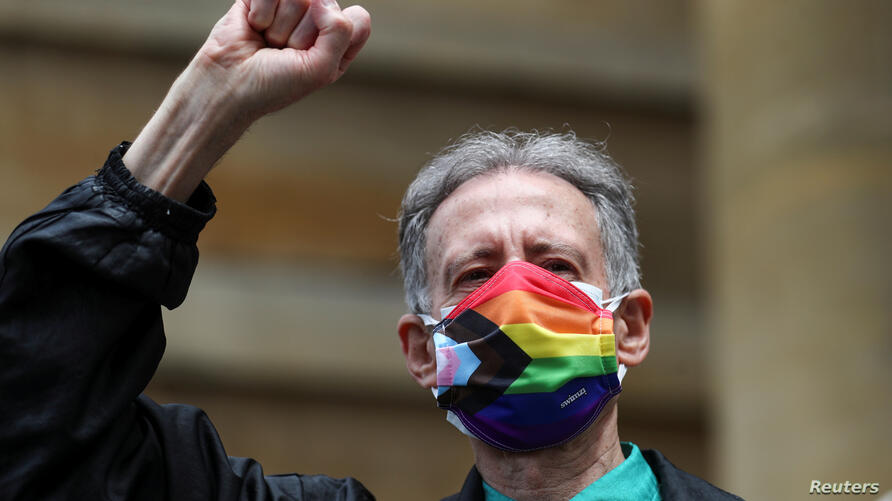 Veteran British LGBT rights campaigner Peter Tatchell wearing a face mask takes part in the Gay Liberation Front (GLF) pride march in London, Britain
