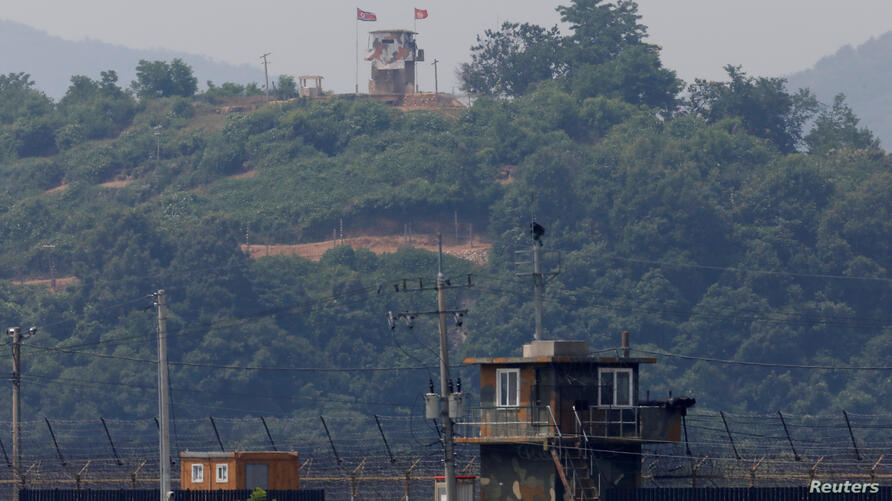 A North Korean soldier stands guard at his guard post inside North Korean territory, in this picture taken from Paju, South Korea, near the demilitarized zone (DMZ) separating the two Koreas