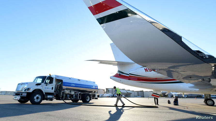 FILE PHOTO: A business jet is refuelled using Jet A fuel at the Henderson Executive Airport during the National Business Aviation Association (NBAA) exhibition in Las Vegas
