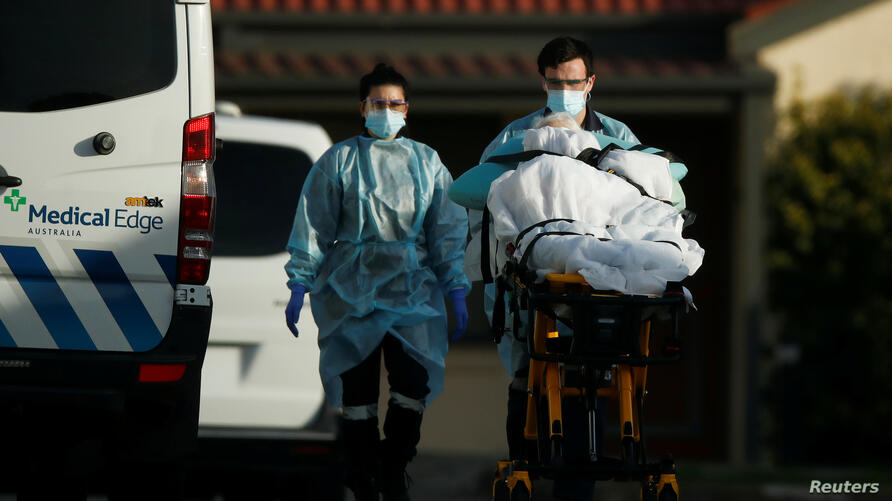 A patient is removed from an aged care facility experiencing an outbreak of COVID-19 in Melbourne