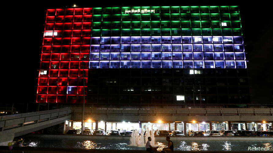 FILE PHOTO: Tel Aviv's municipality building is lit in the United Arab Emirates national flag after a deal to normalise relations between Israel and the UAEthe countries