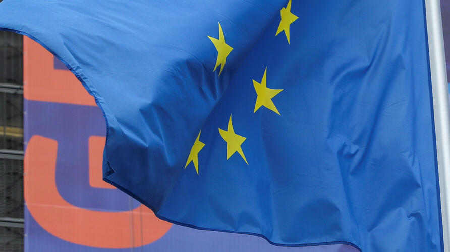 A European Union's flag flutters outside the European Commission headquarters in Brussels