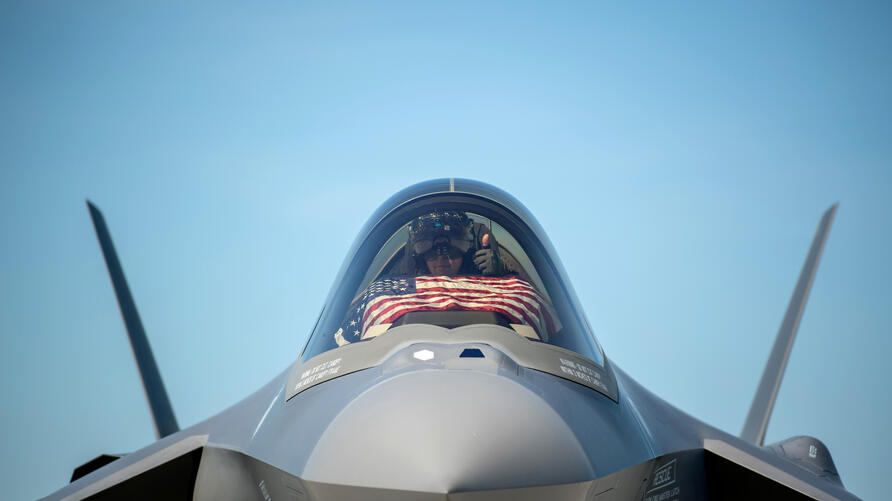 FILE PHOTO: An F-35 pilot prepares for take off from the Vermont Air National Guard Base with the flag of the United States