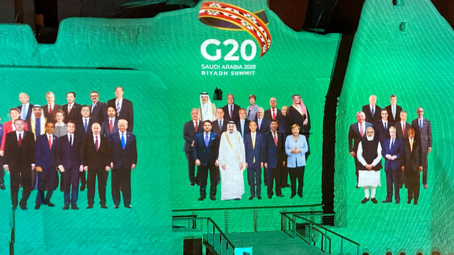 """FILE PHOTO: """"Family Photo"""" for annual G20 Summit World Leaders is projected onto Salwa Palace in At-Turaif, one of Saudi Arabia's UNESCO World Heritage sites, in Diriyah"""