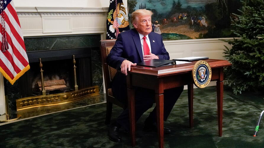 U.S. President Donald Trump arrives to a Thanksgiving video teleconference with members of the military forces at the White House in Washington