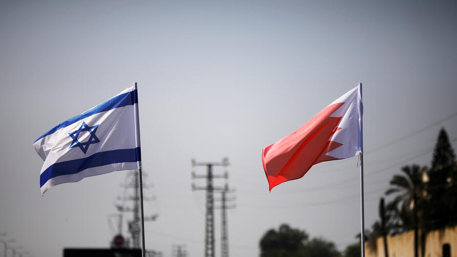 FILE PHOTO: The flags of Israel and Bahrain flutter along a road in Netanya